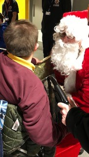Image of Father Christmas meeting young people at the party