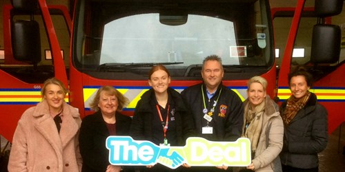 Image of Rebecca and council members in front of a fire engine